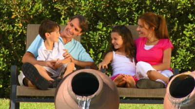 Family on bench in garden